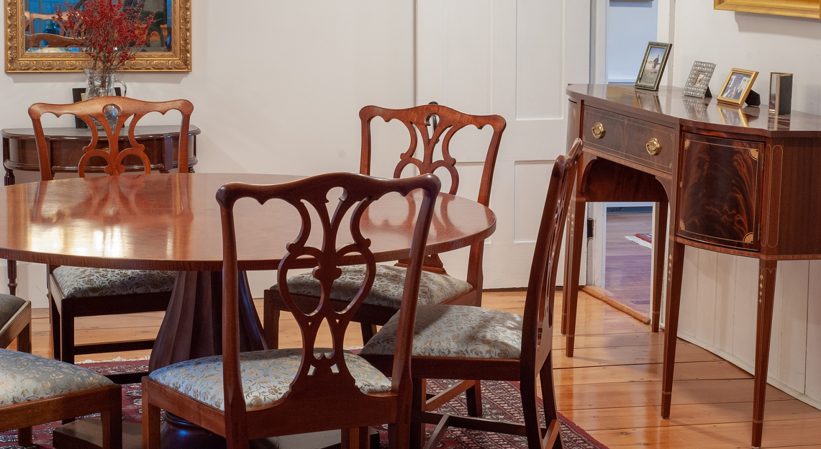 Dining table and chairs with a side table, created by Roger Myers