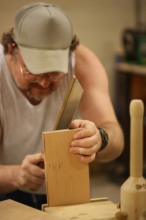 A participant in the Maine Prison Outreach program working on a piece