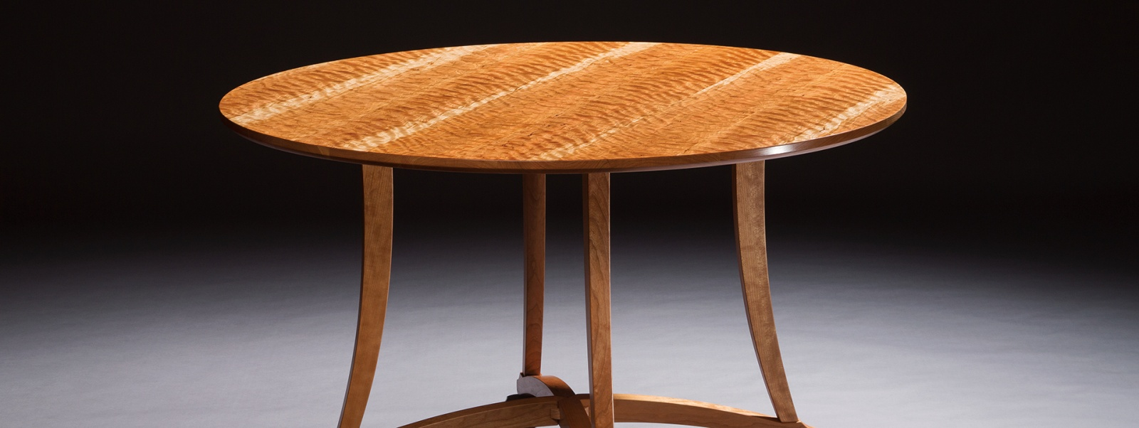 Custom handmade dining table created by furniture master Timothy Coleman